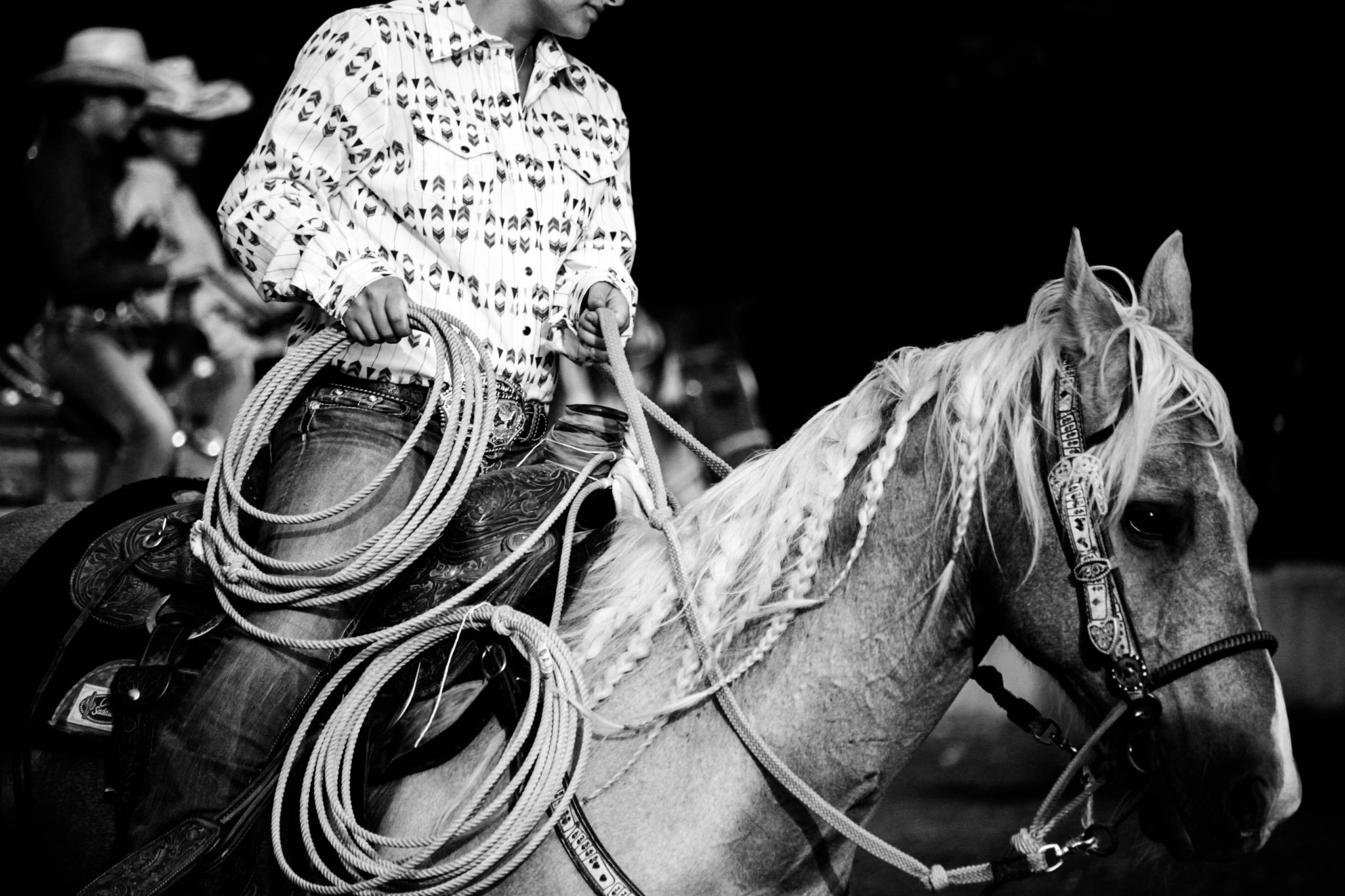 grayscale photography of man riding horse