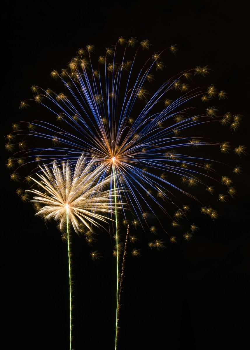 white and yellow fireworks display during nighttime